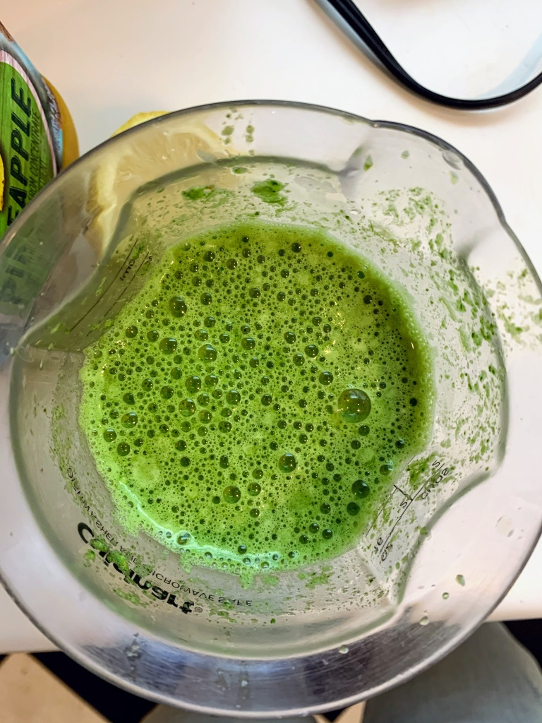 Close up bird's eye view of green smoothie