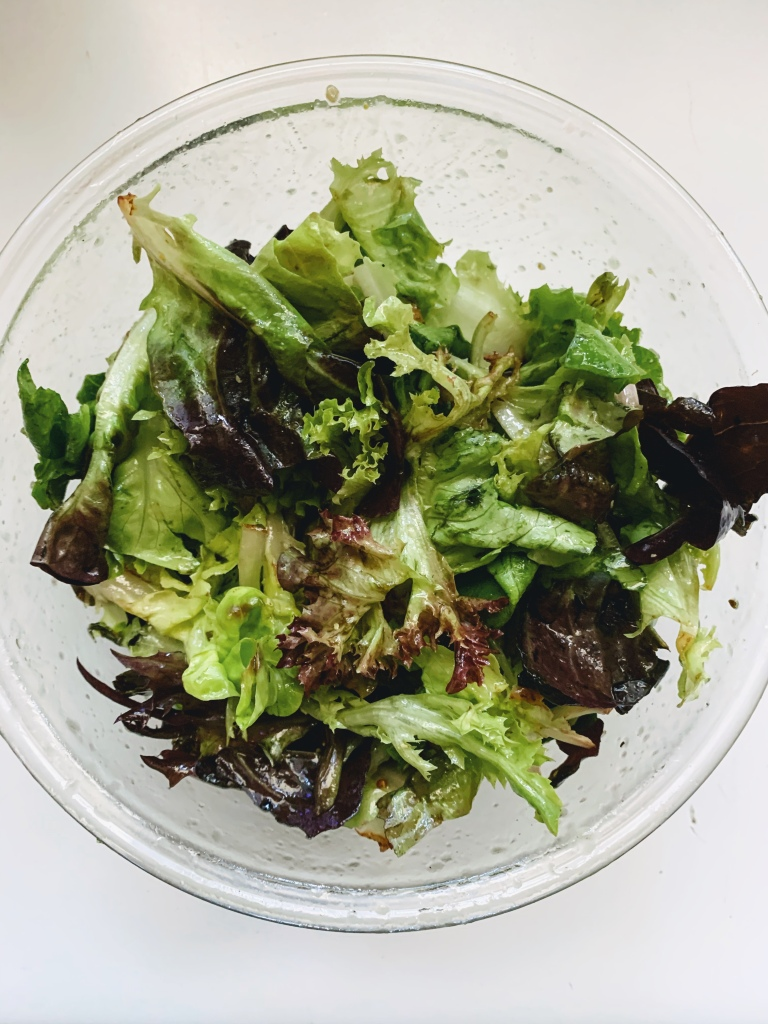 Overhead of dressed mixed greens