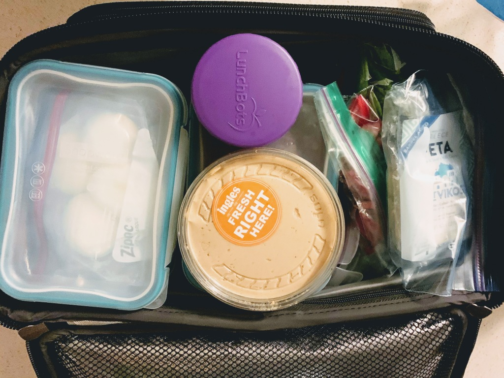Large lunchbox with food-packed Tupperware & ziplock bags