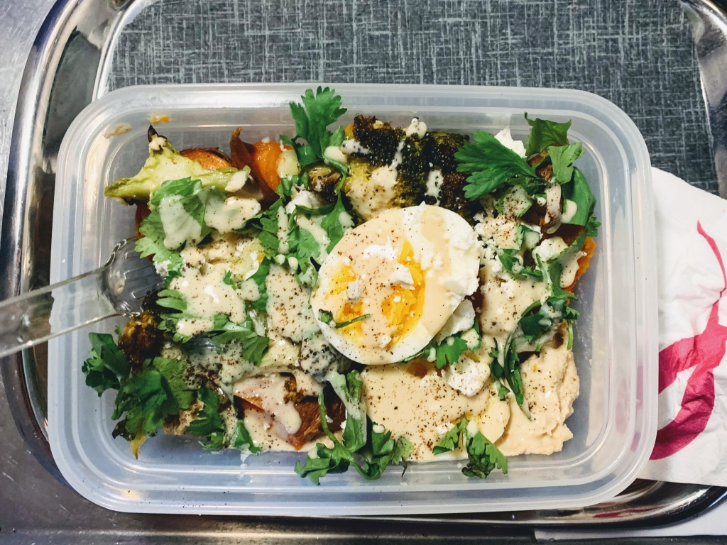 A meal-prep veggie & egg bowl on the airplane