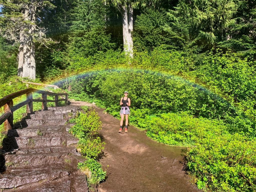 Posing underneath a perfect rainbow