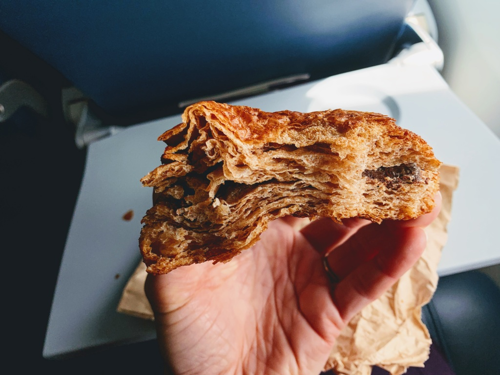 Half-eaten whole wheat chocolate croissant
